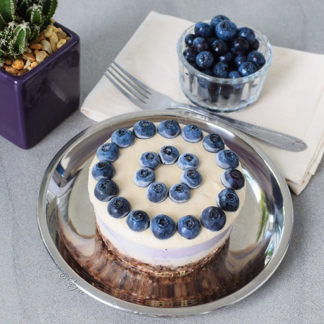 Frozen mini cake with blueberries on top