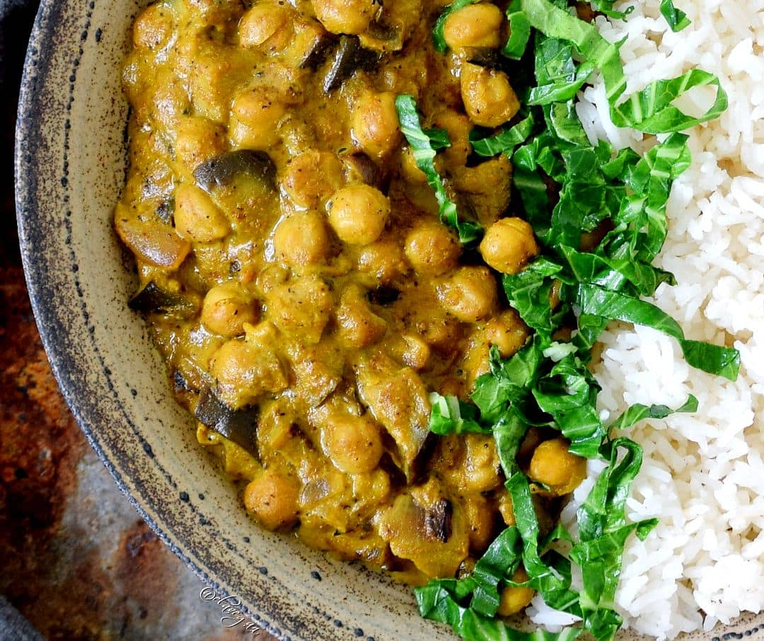 Close-up of vegetarian Indian dish with rice, chickpeas, and spinach