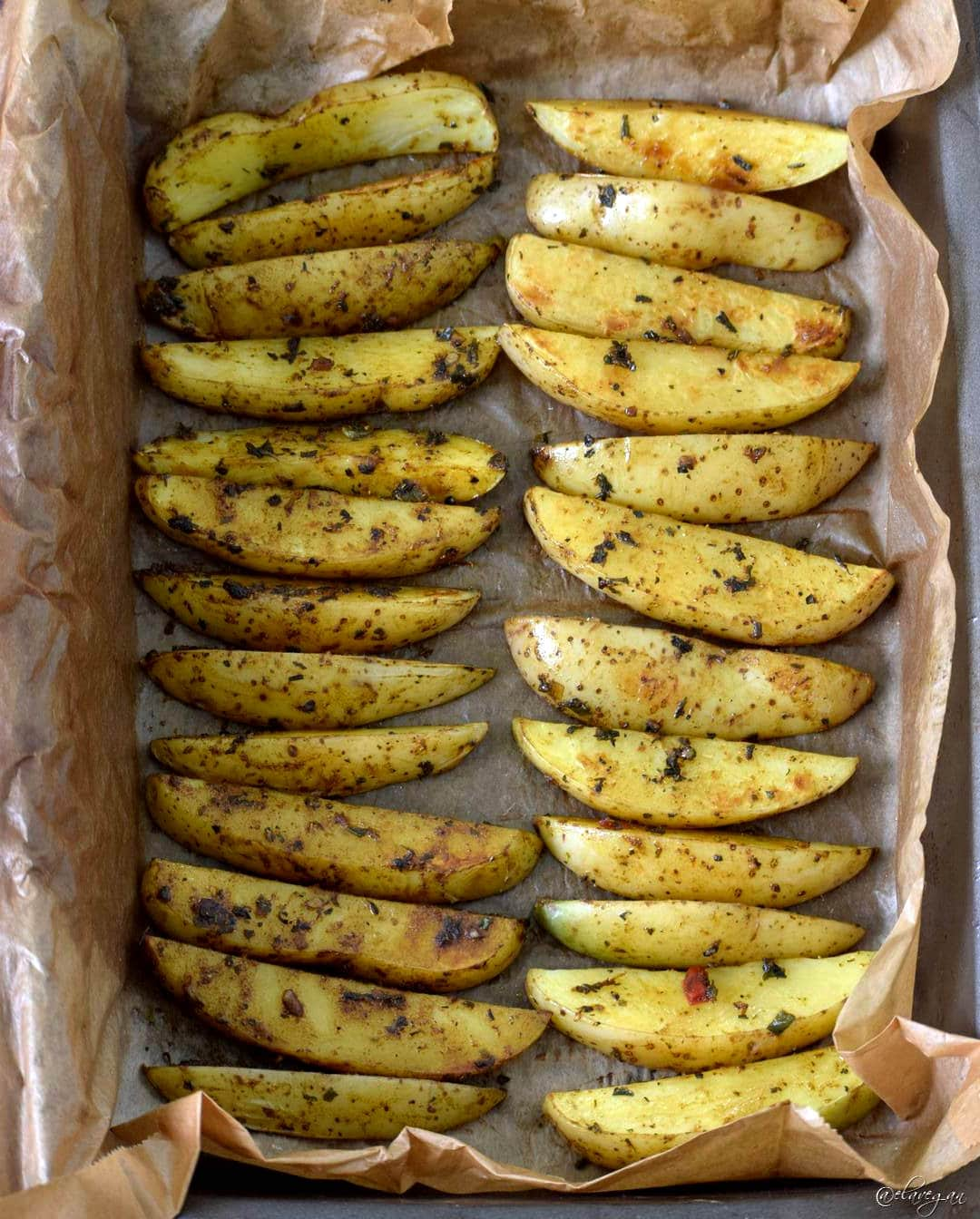 oven baked potato wedges recipe - on baking sheet - low in fat and not deep fried