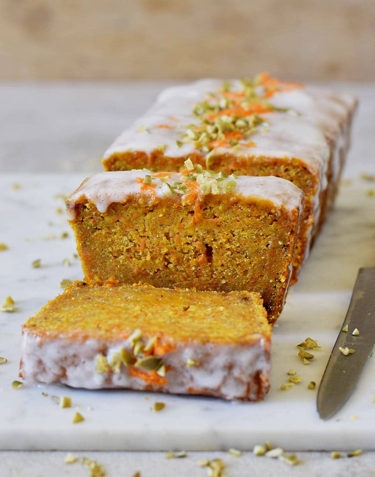 moist vegan carrot cake loaf with sugar-free icing