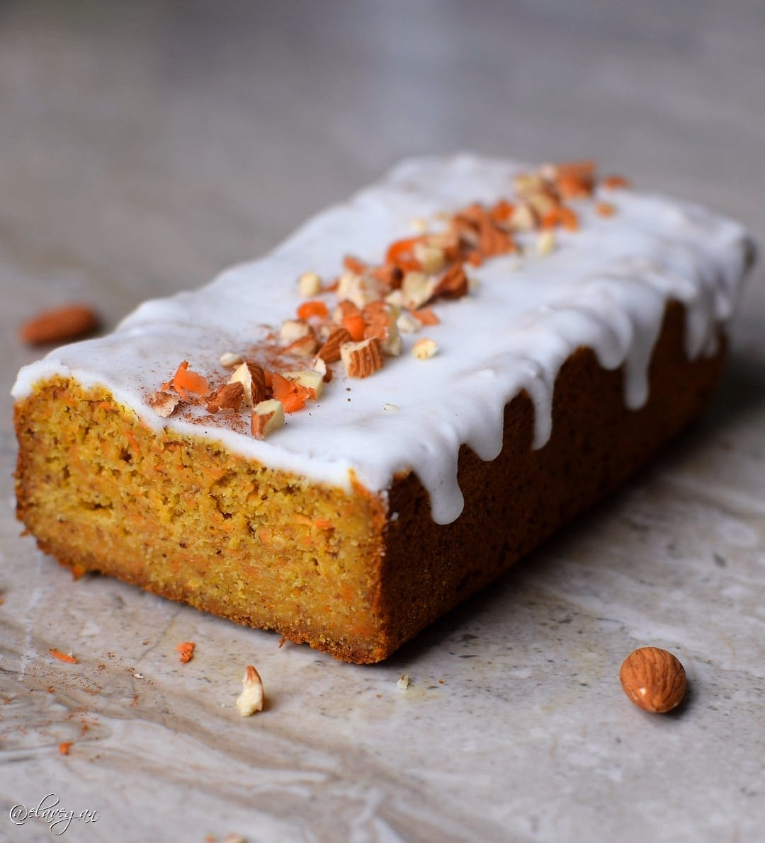 Vegan gluten-free carrot cake with a white sugar-free (keto friendly) frosting