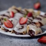 Vegan gluten free crepes filled with a homemade low fat chocolate spread and strawberries - easy recipe