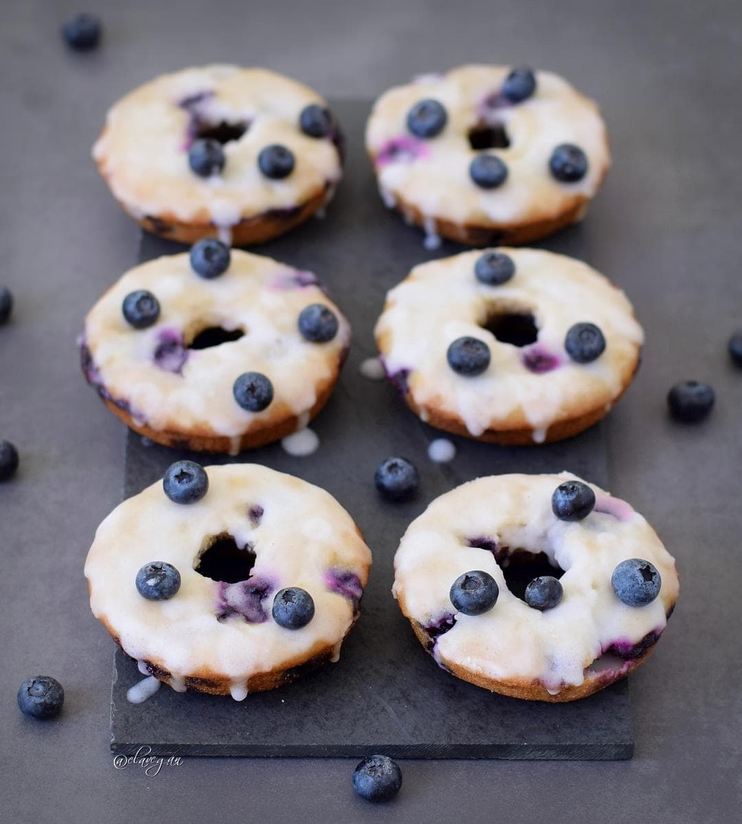 Baked blueberry donuts with a sugar free lemon glaze. These blueberry donuts are vegan, gluten free, refined sugar free, low in fat, healthy and delicious. Easy to make recipe!