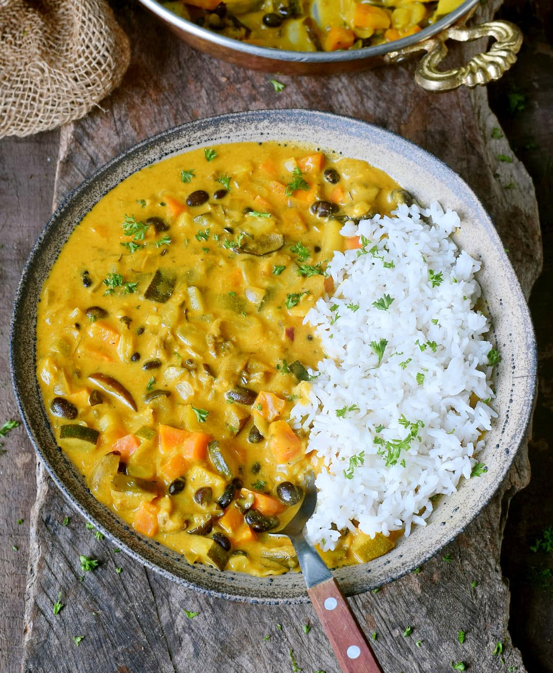 healthy vegetable curry recipe with coconut milk and pineapple in a bowl
