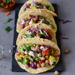 Vegan chickpea tacos recipe with avocado and a tahini dressing. These vegan tacos are gluten-free, healthy, easy to make, and delicious. Homemade tortillas recipe included