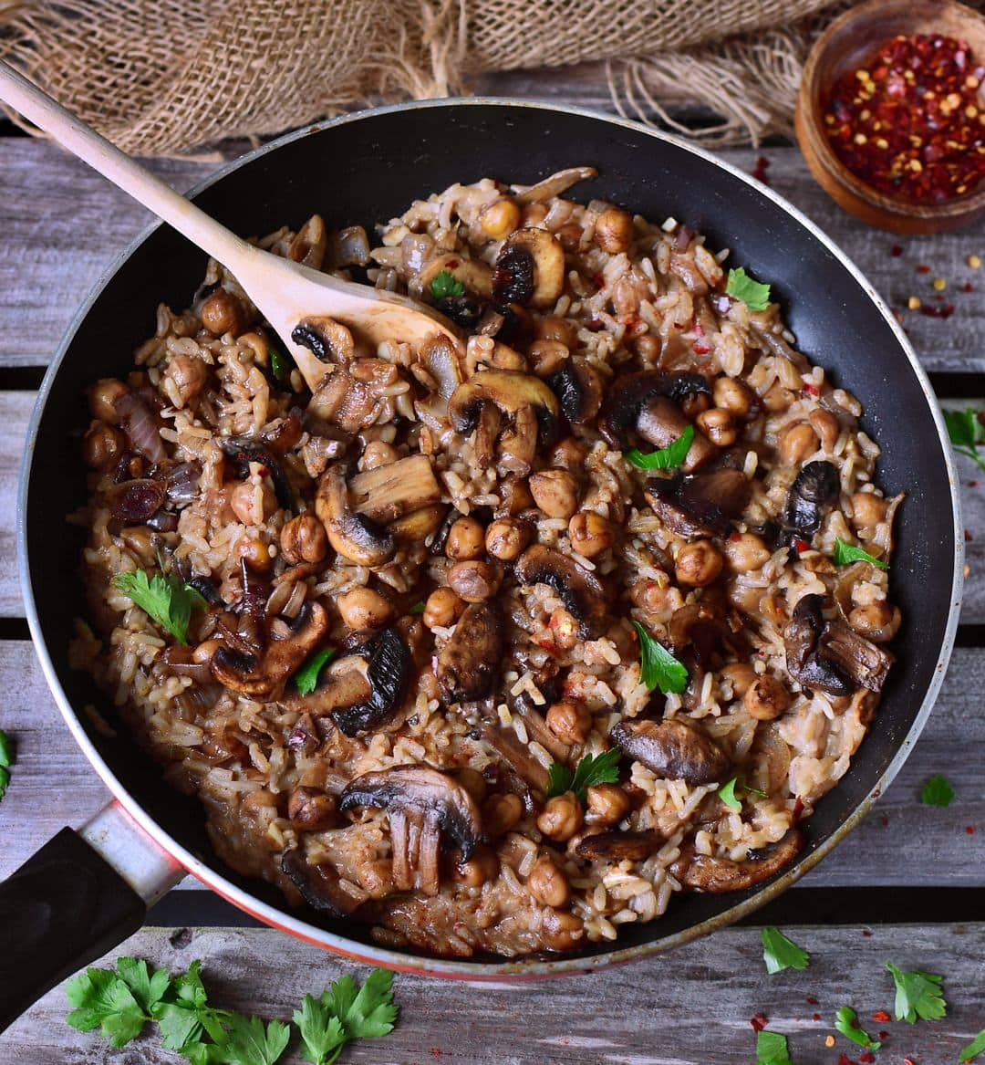 Vegan mushroom risotto in a creamy coconut sauce. This risotto is plant-based and gluten-free and contains healthy protein from chickpeas. A flavorful and easy to make recipe.