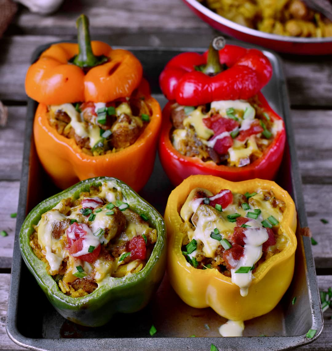 4 vegan stuffed bell peppers with plant-based cheese, rice, textured soy protein and healthy veggies