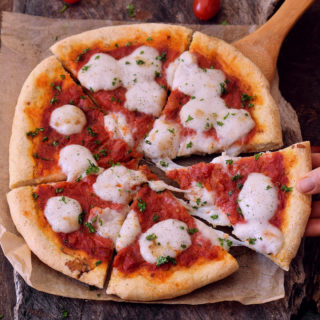 Best gluten-free pizza crust which is crispy, fluffy and not only great for all kind of pizzas (e.g. Pizza Margherita) but also for flat-bread and Calzone. The dough is crispy, vegan, egg-free, dairy-free, gum-free and easy to make.