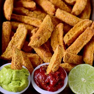 These crispy oven-baked vegan parmesan potato wedges are 100% plant-based, gluten-free, easy to make and flavorful. They are a great side dish, snack or appetizer. Enjoy with ketchup, guac, or mayo