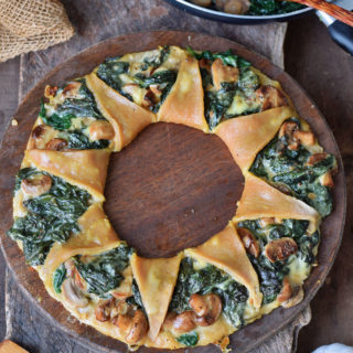 Gluten-free Pizza ring with spinach mushrooms and vegan cheese