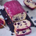 sliced blueberry bread with maqui berry frosting