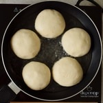 vegan gluten-free steamed yeast dumplings in pan before cooking