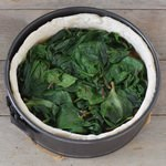 Vegan deep dish pizza gluten-free dough with spinach