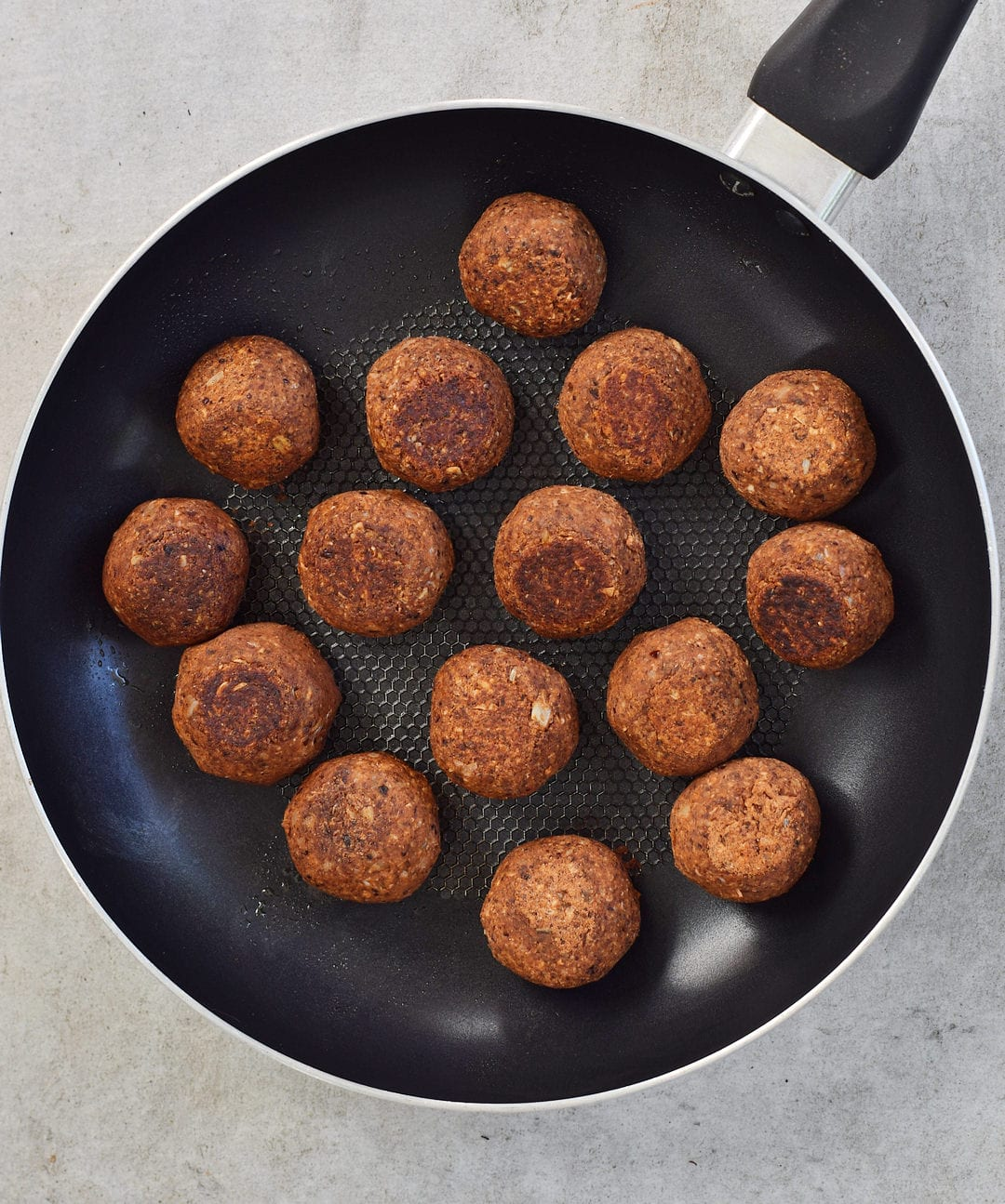 Vegan meatballs in a skillet