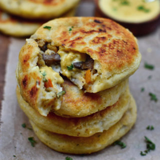 Gluten-free stuffed potato cakes with vegan cheese sauce