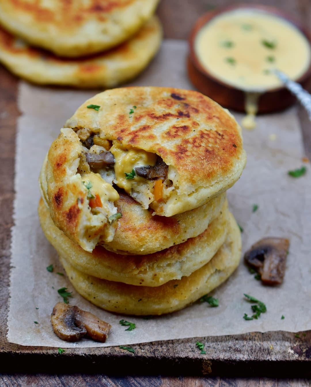 Stuffed potato cakes with mushrooms, veggies and vegan cheese sauce