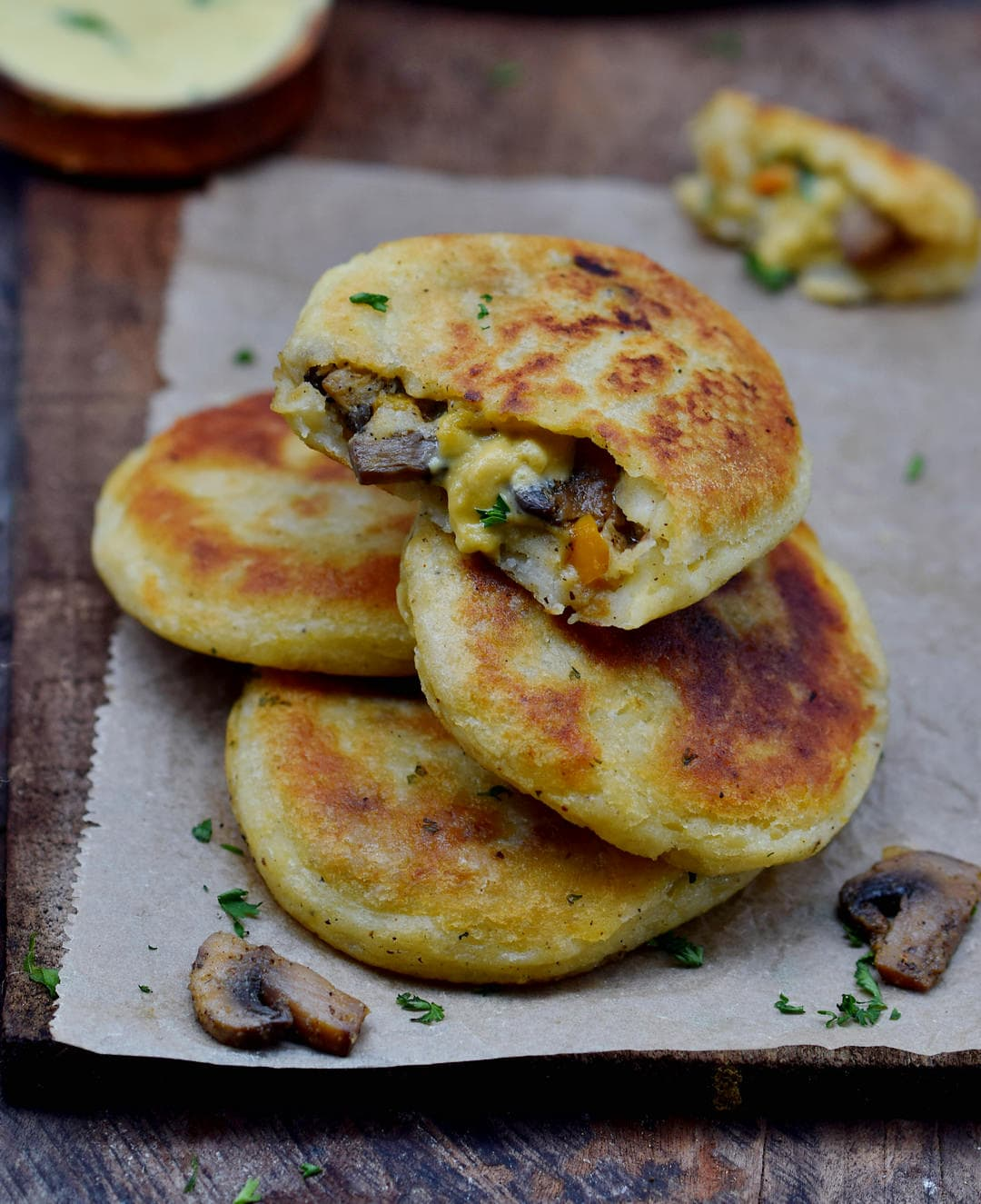 Mushroom stuffed potato cakes with vegan cheese sauce