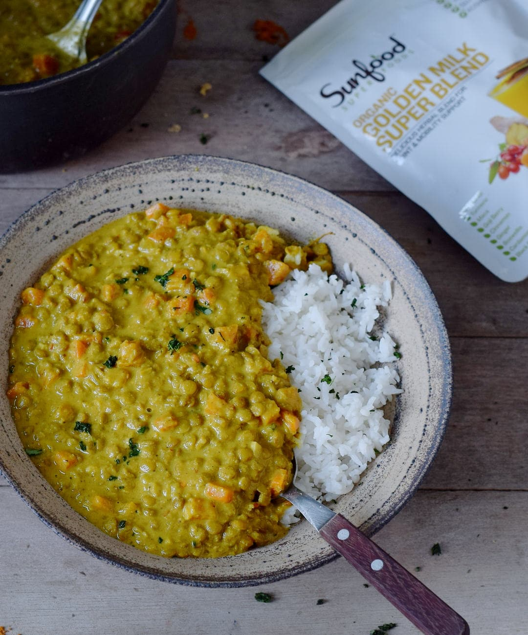 lentil dal with rice on a plate with Sunfood Golden Milk Super Blend