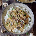 vegan mushroom stroganoff served with gluten-free rice in a bowl