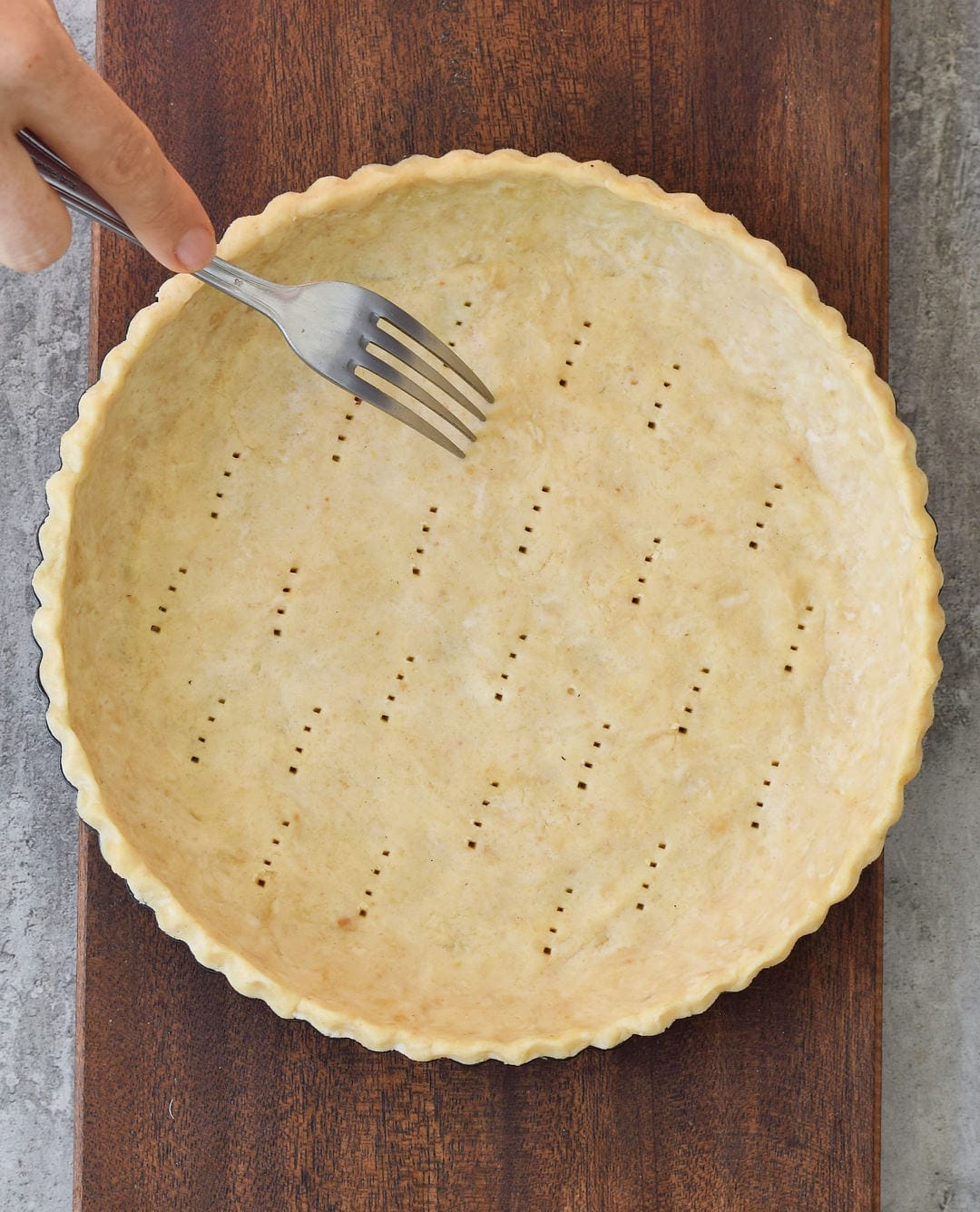 gluten-free pie crust with fork on a wooden board