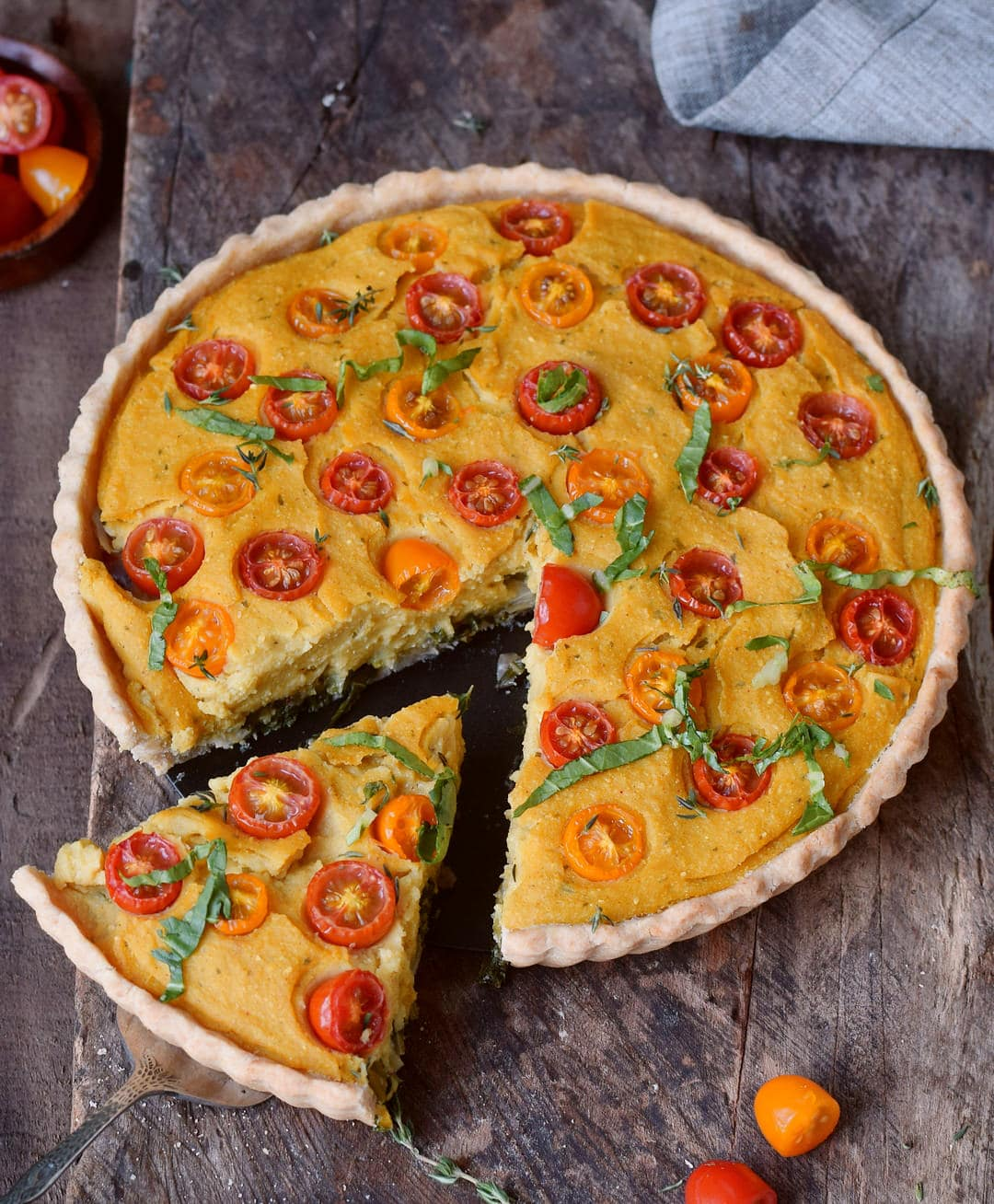 veggie frittata with pie crust with a piece cut out