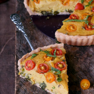 gluten-free vegan quiche (soy free) with a piece in the front