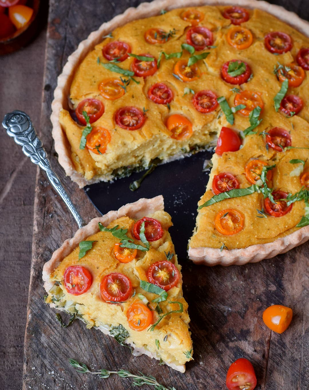 vegan quiche with a piece in the front