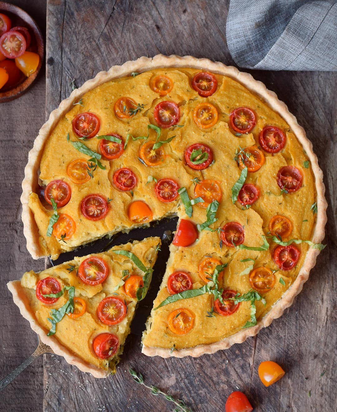 vegan quiche with a piece cut out from above