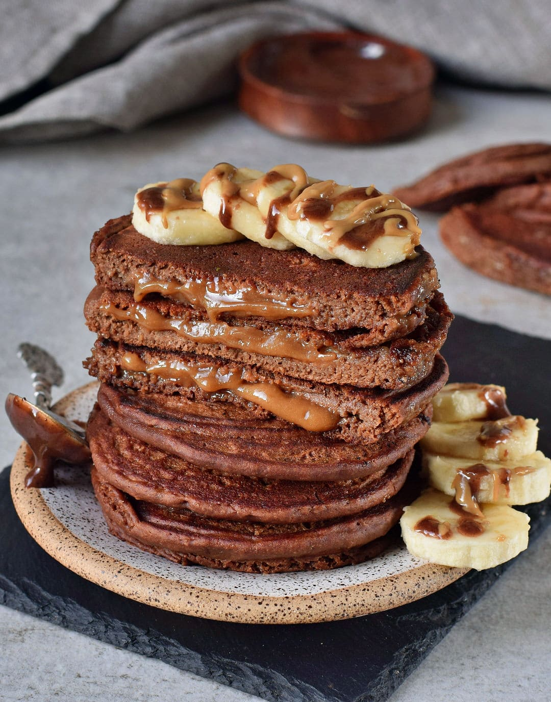 Caramel chocolate pancakes with banana slices vegan recipe