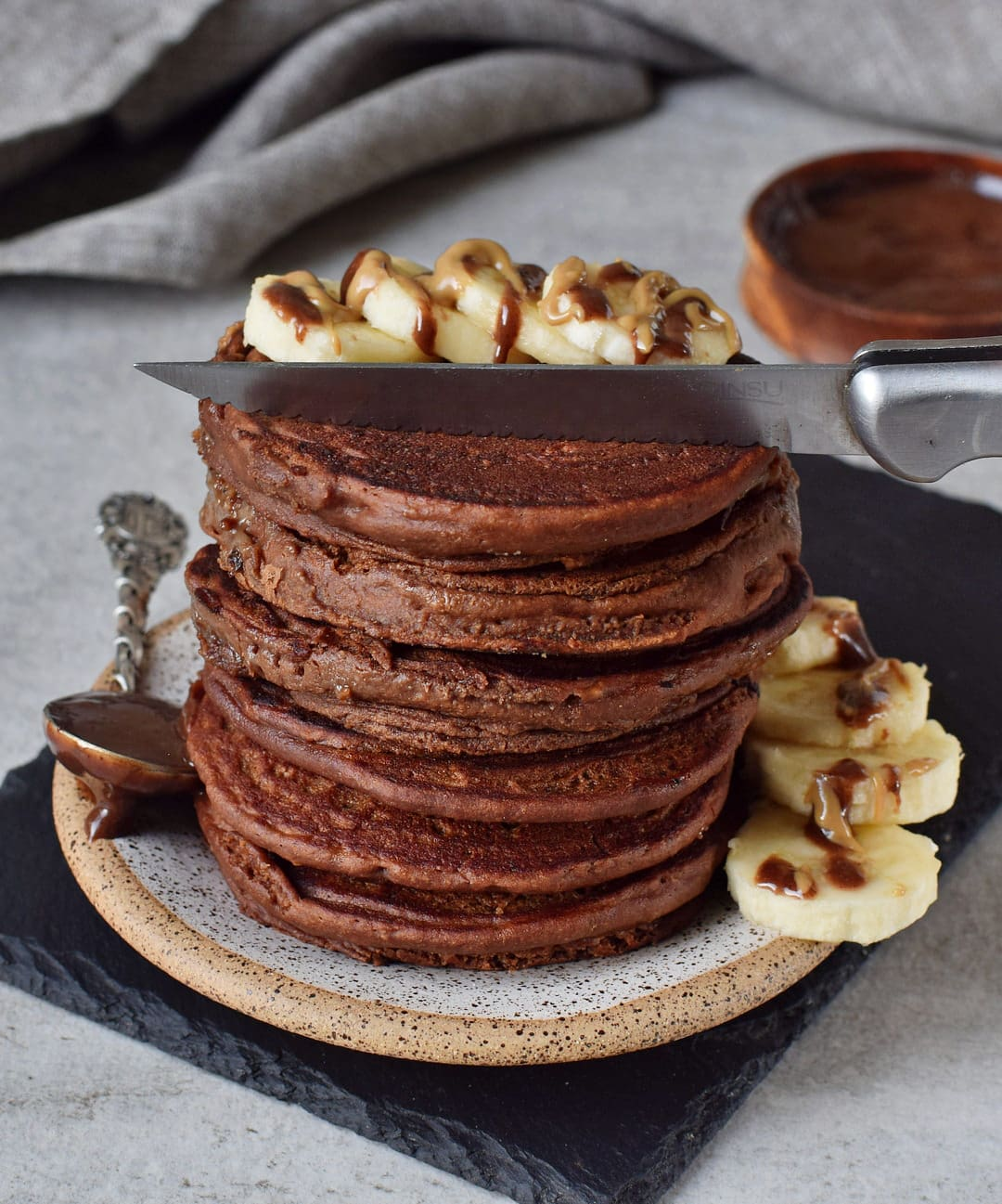 Gluten-free caramel chocolate pancakes with banana slices