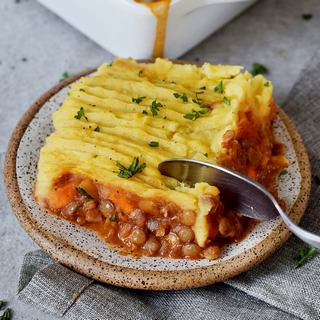 piece of a vegan shepherds pie with a spoon