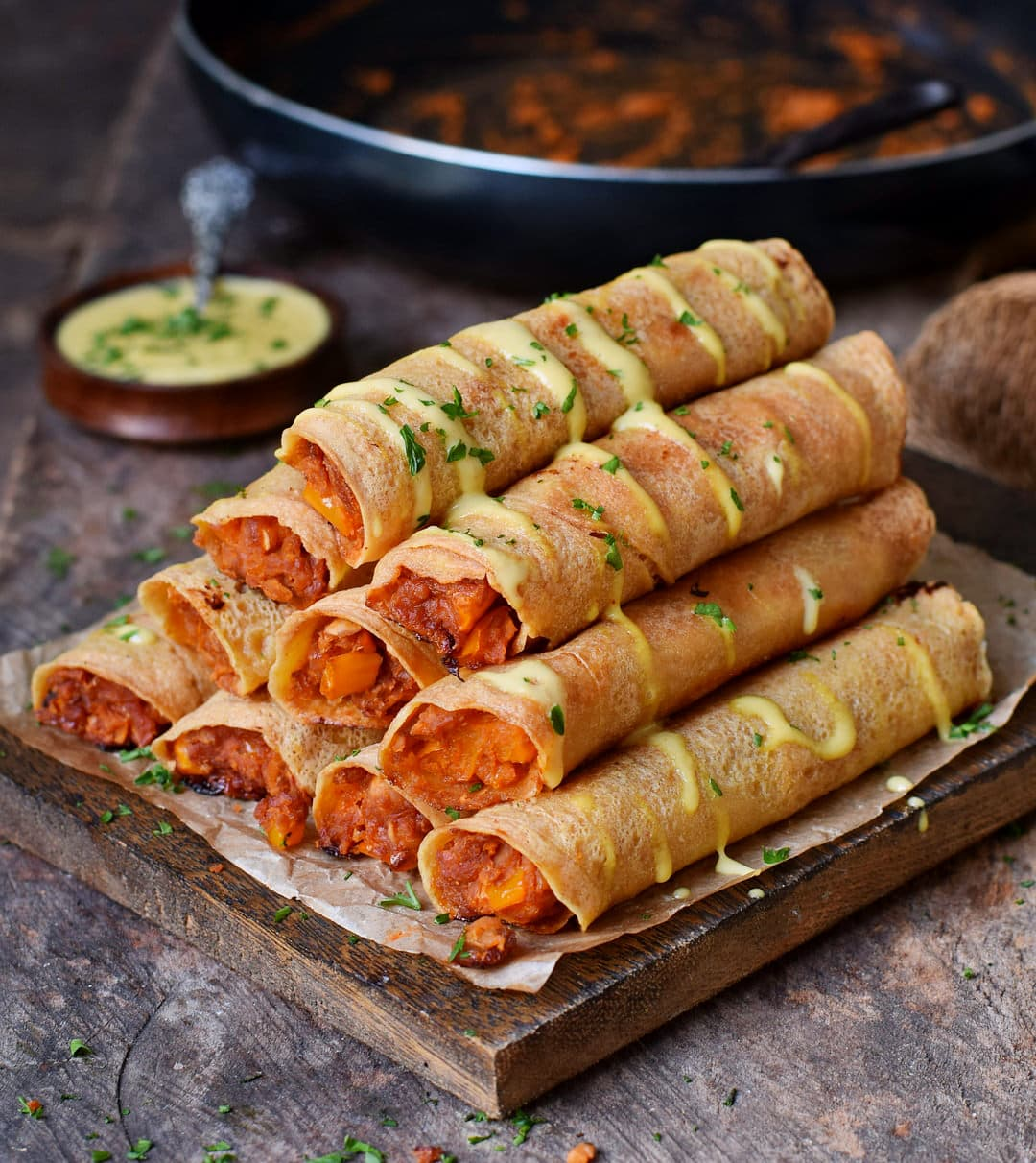 Baked Buffalo chickpea taquitos from the side