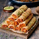 Gluten-free Buffalo chickpea taquitos with vegan cheese drizzle 150x150