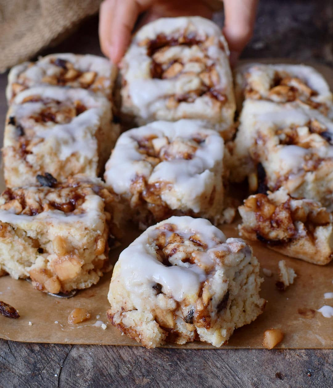 eating vegan apple cinnamon rolls