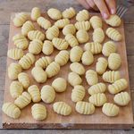 Homemade gluten free vegan gnocchi before cooking on a cutting board 150x150 1