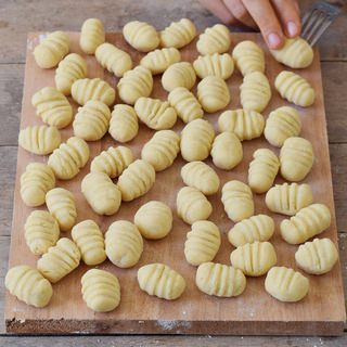 Recipe or homemade gluten-free vegan gnocchi before cooking on a cutting board 320x320