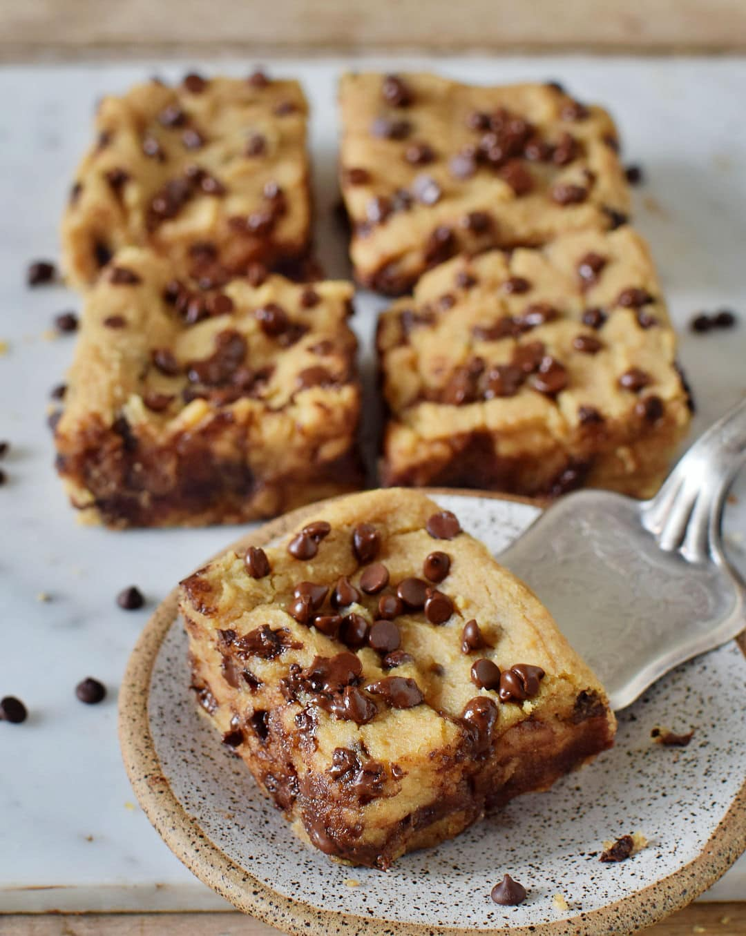 gluten-free vegan chocolate chip blondies on a plate