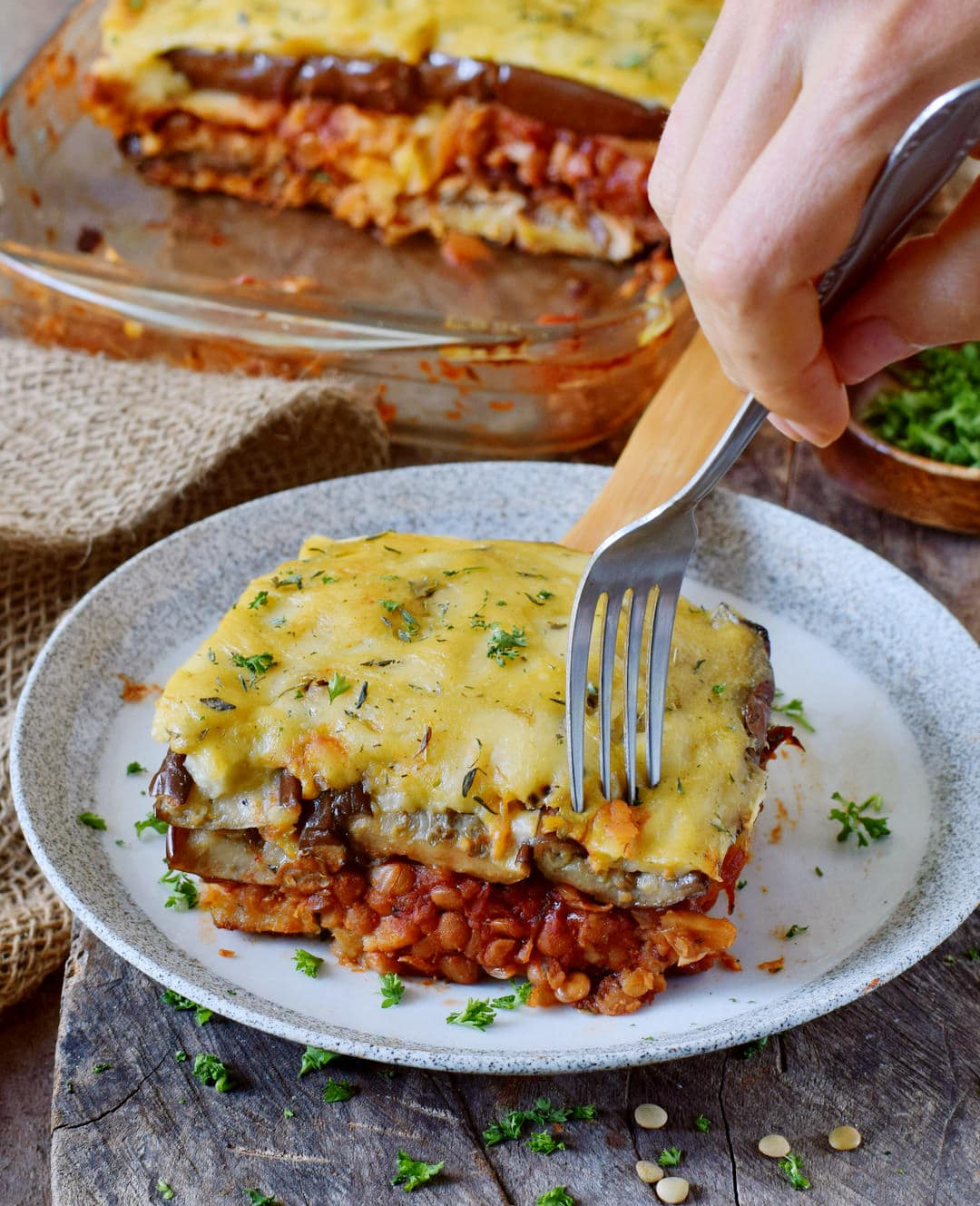 gluten-free vegan moussaka on a plate with a fork