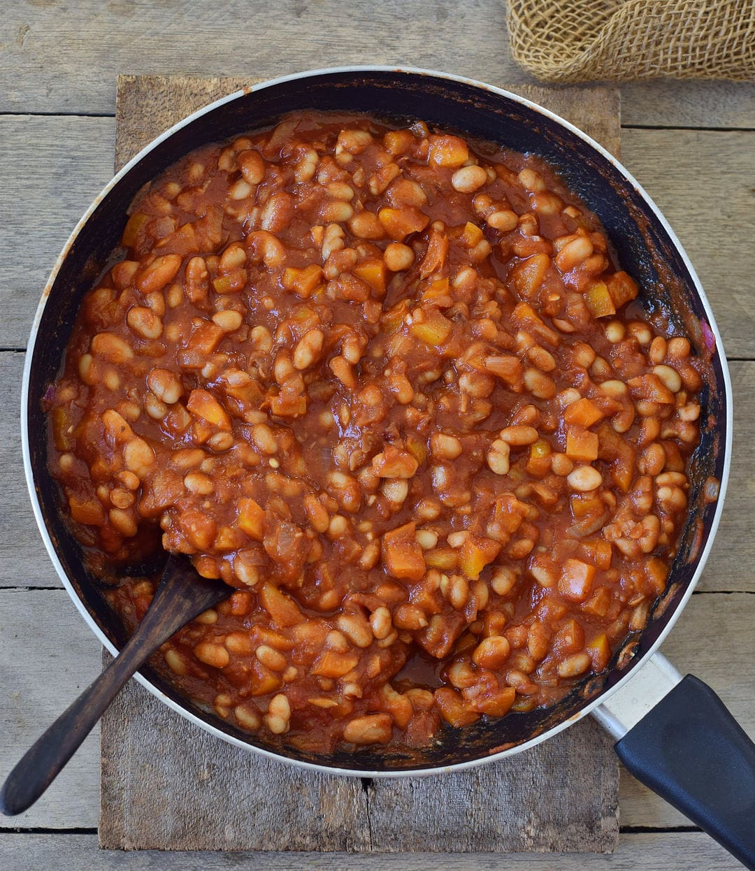 tomato sauce with cannellini beans in a pan