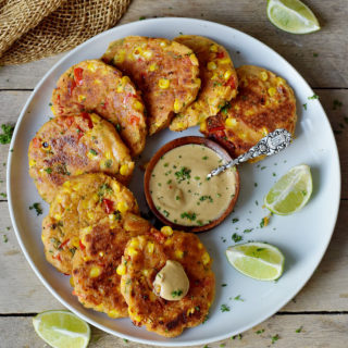 vegan veggie fritters with corn pepper gluten-free recipe on a plate 320x320