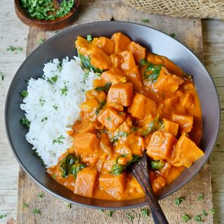 Creamy Vegan Coconut Curry with spinach sweet potatoes and rice