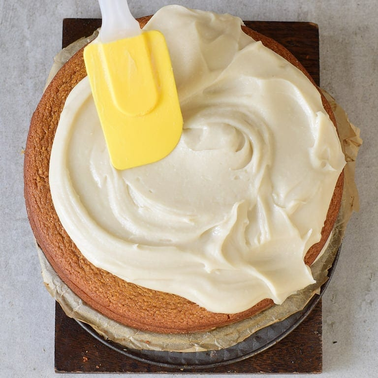 frosting cake with white cream