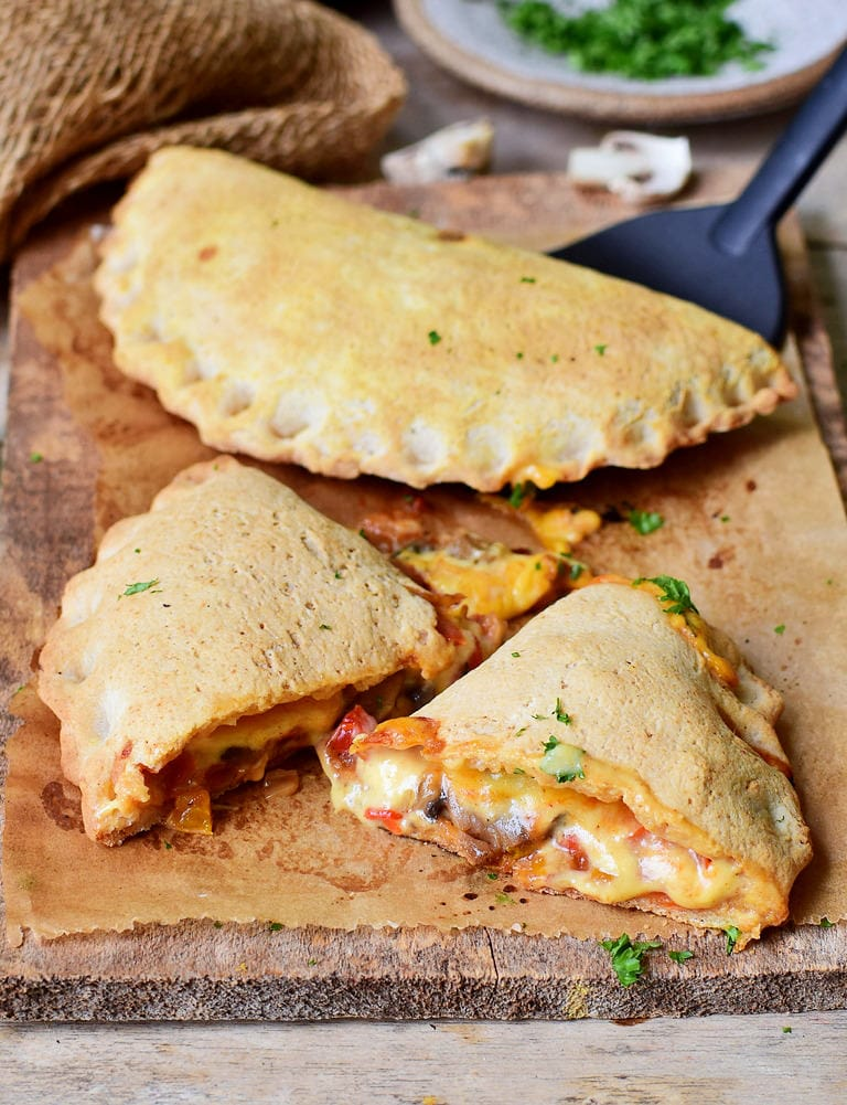 pizza calzone pocket with mushrooms peppers and vegan cheese
