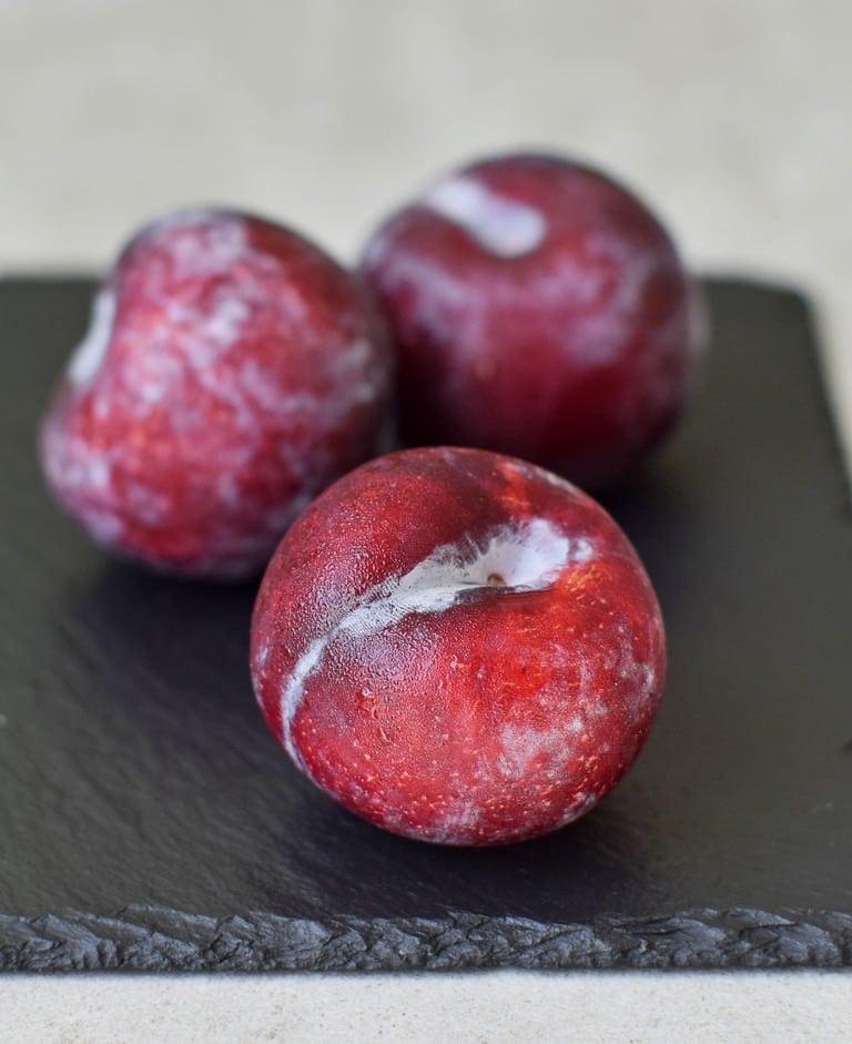 3 plums of a slate plate