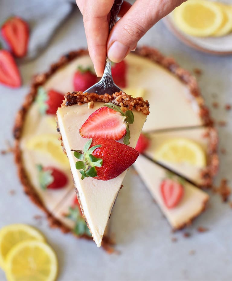One slice of vegan lemon cheesecake tart with granola crust