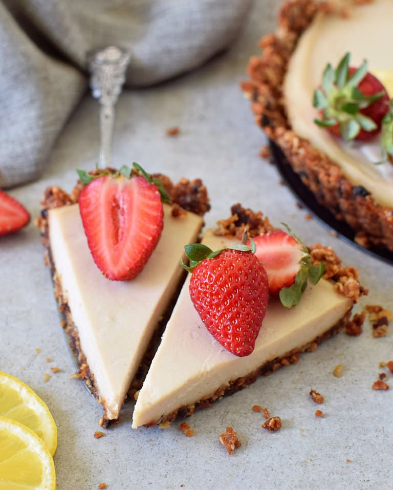 Two slices of vegan lemon cake/pie with granola crust