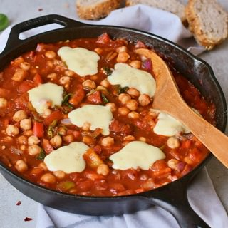 Tomato stew with chickpeas in a black pan