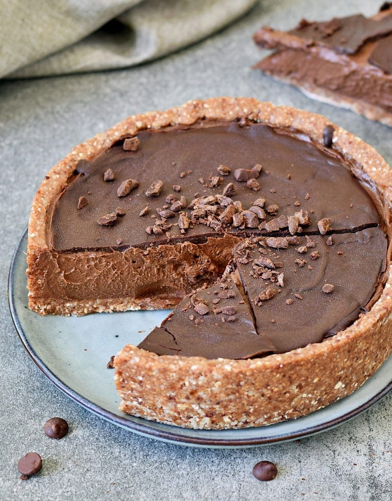 Creamy dairy-free chocolate cake (tarte) on a plate