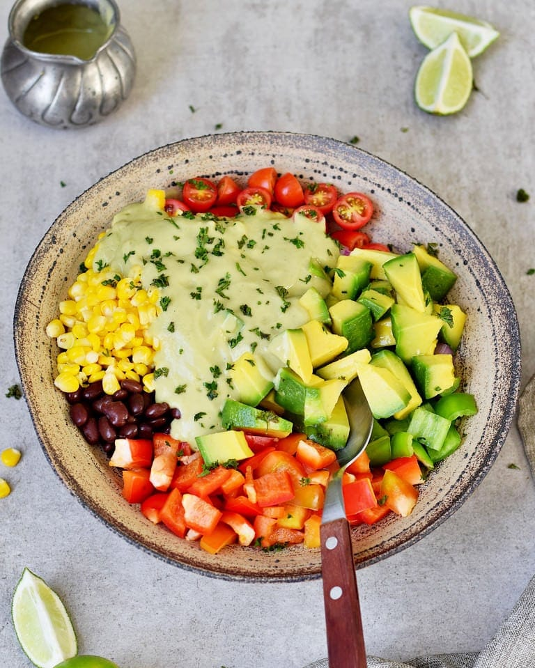 Healthy avocado salad with corn, black beans, and oil free dressing