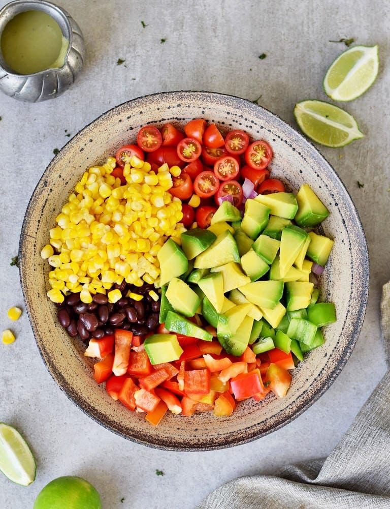 Mexican avocado salad assembled in a bowl